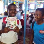 excited boy checks out book hopkins belize